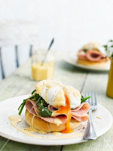 Eggs Benedict with ham and basil