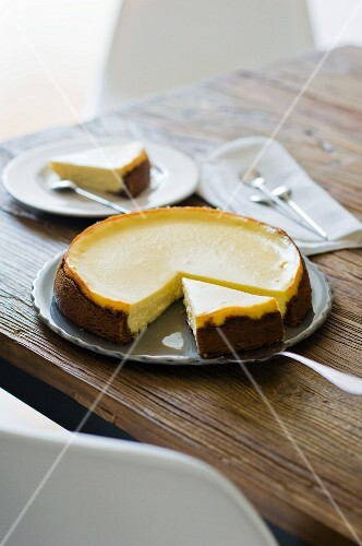 Classic Manhattan cheesecake, partly sliced
