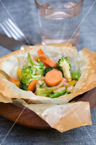 Carrots with summer vegetables in a pastry bowl