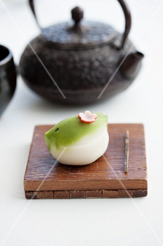 Wagashi nightingale (for New Year) with a teapot (Japan)