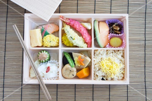 Bento box with fish, tempura, rice etc. (Japan)