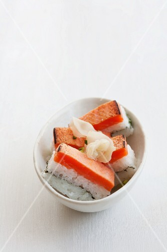 Oshi sushi with seared salmon and pickled ginger (Gari)