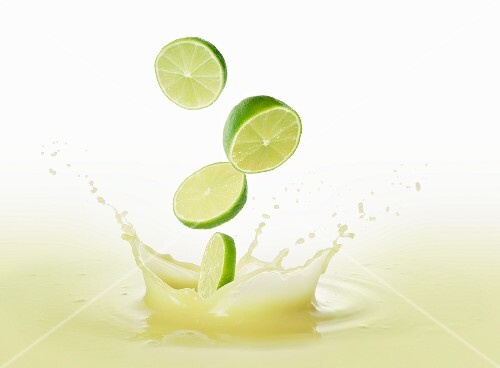 Limes falling into lime juice