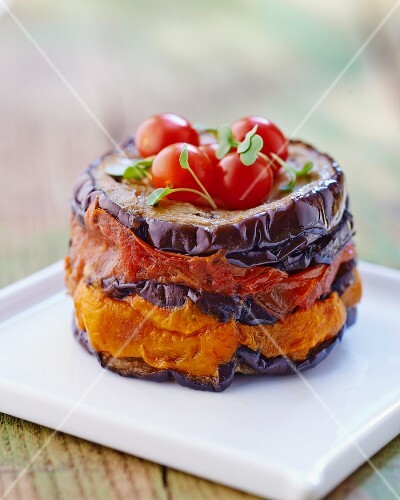 A stack of chargrilled aubergine with tomatoes