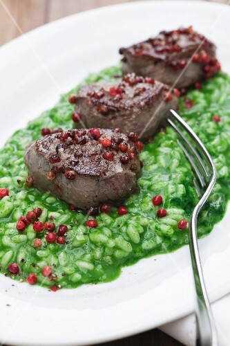 Parsley risotto with venison fillets and pink peppercorns