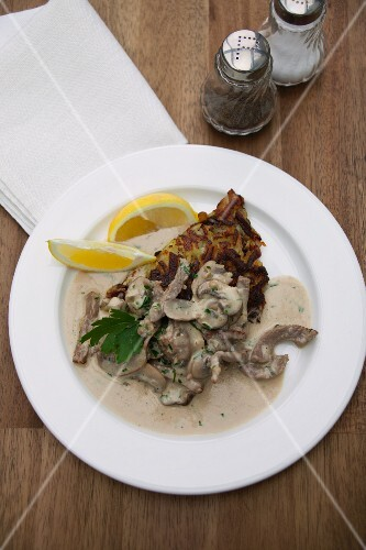 Veal with fresh mushrooms and fried potato cakes