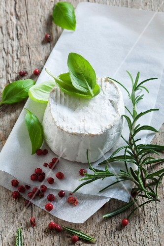 Goat's cheese with basil, rosemary and red peppercorns