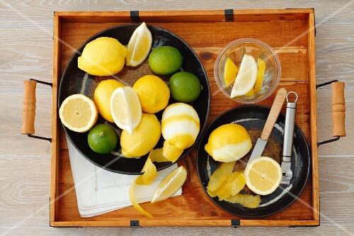 Lemons and limes (whole, cut in half, wedges and lemon peel)