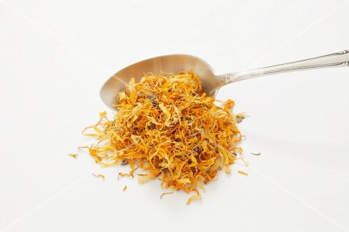 Dried marigolds with a spoon