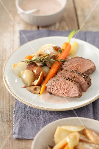 Roast fillet of venison with rosemary, vegetables and porcini mushrooms