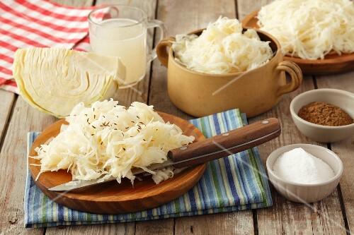 Sauerkraut, white cabbage, salt, ground caraway and sauerkraut juice