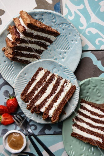 Chocolate layer cake with strawberries and caramel sauce