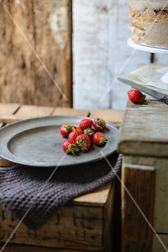 Fresh strawberries and a cream layer cake
