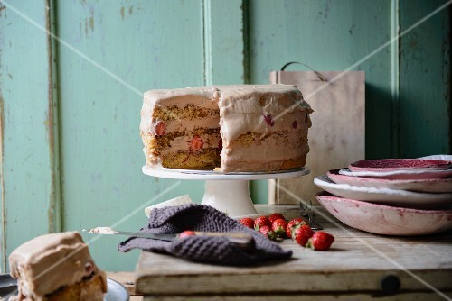 Strawberry layer cake with almond sponge, chocolate and salted caramel mousse