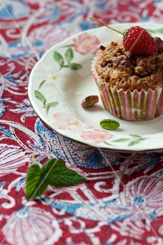 A raspberry and pistachio muffin