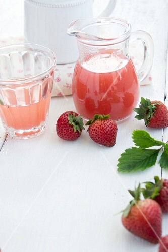 Homemade strawberry syrup and fresh strawberries