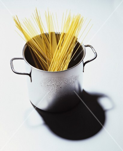 Uncooked spaghetti in a pan