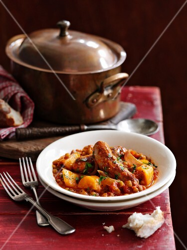 Lentil and tomato stew with sausage