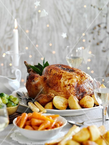 Roast turkey with potatoes and carrots for Christmas