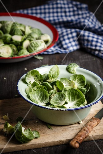 Brussel sprout leaves in an enamel bowl