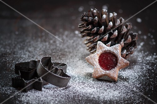 Christmas cookie in front of a pine cone, old cookie cutter