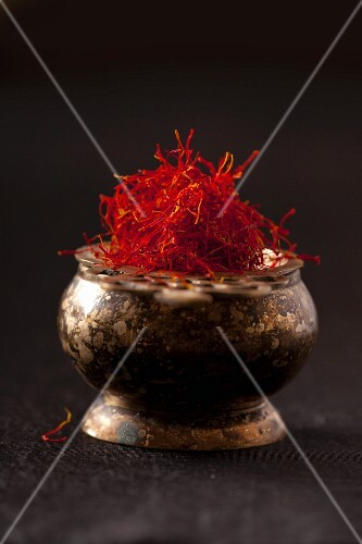 Saffron strands in a rustic bowl