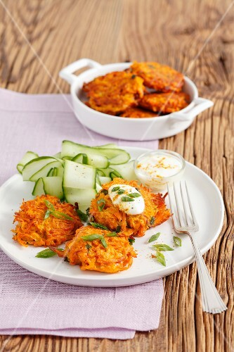 Carrot fritters with curry, spring onions and cucumber salad