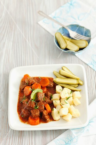 Beef stew with carrots, potato gnocchi and pickled gherkins
