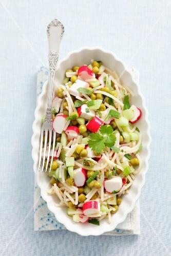 Noodle salad with surimi, cucumber, peas and coriander
