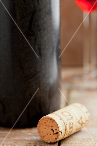 A wine cork with an old wine bottle