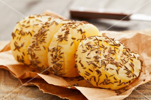 A roll of handmade Harzer (sour milk cheese) with caraway seeds