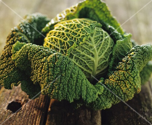 Savoy cabbage on a rustic wooden table