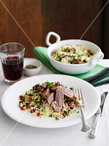 Lamb with harissa on couscous with pomegranate seeds