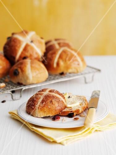 Hot cross bun, sliced in half with butter