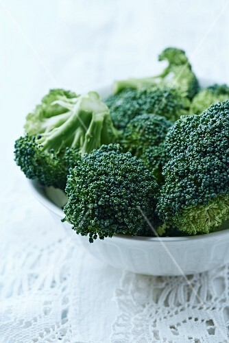 fresh broccoli in a white bowl; close up
