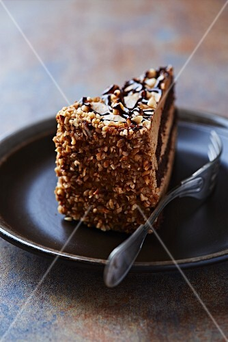 Nut and chocolate layer cake on a plate