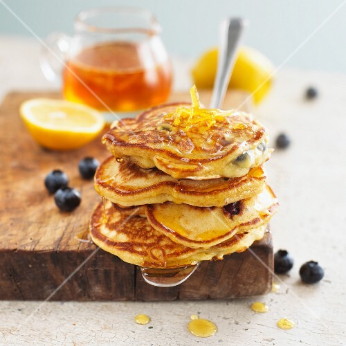 Pancakes with blueberries, lemon and maple syrup