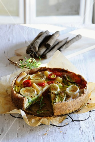Black salsify quiche with cherry tomatoes and goat cheese