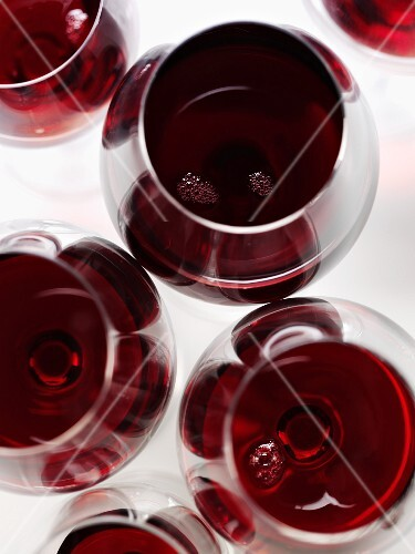 Several glasses of red wine seen from above