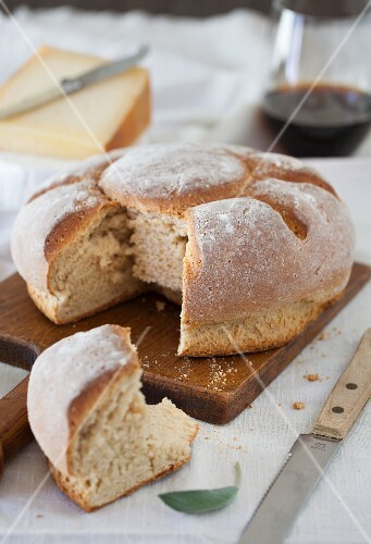 A Loaf of Bread with Cheese and Wine