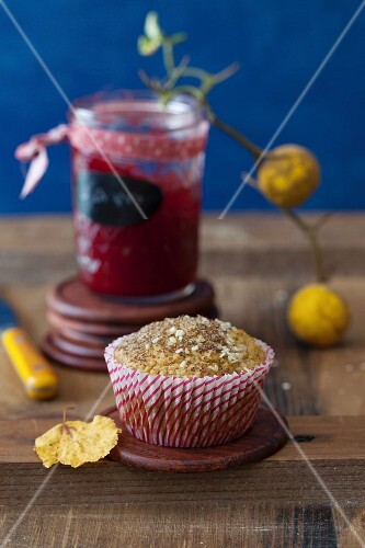 An Oat Muffin with a Jar of Jam