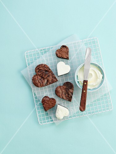 Heart-shaped chocolate tartlets with cream cheese frosting