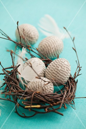 An Easter nest with paper-clad Easter eggs