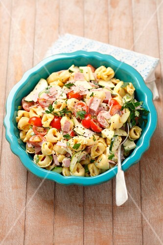 Tortellini salad with ham, tomatoes, cucumber and mayonnaise