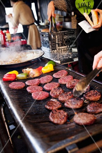 Burgers on the grill at a restaurant