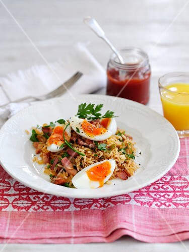 Kedgeree (rice dish, England) with bacon and egg