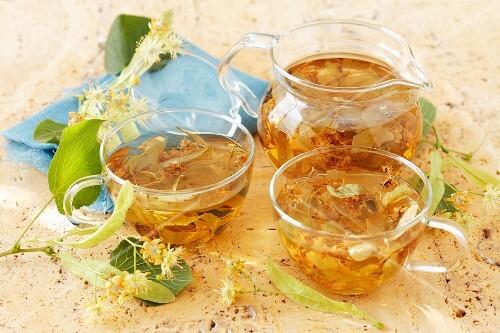Limeflower tea in a glass jug and glass teacups