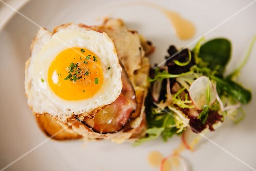 Croque Madame (toast topped with dry-cured ham, grilled cheese and a fried egg)