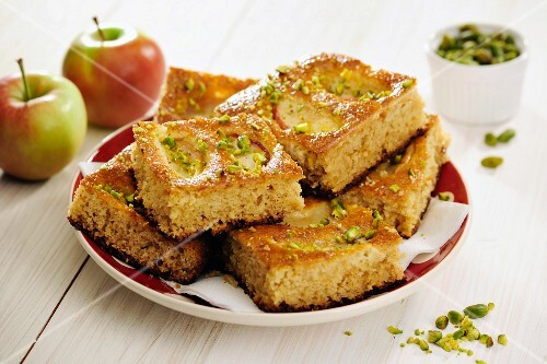 Slices of delicious Whole-Wheat Apple Cake with Pistachios