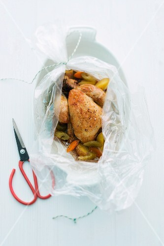 Spring chicken with vegetables in a roasting bag